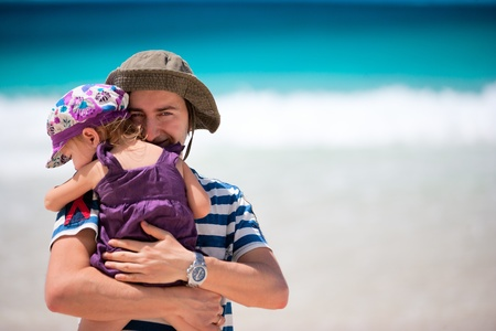 Portrait of happy father and his adorable little daughter at beach Stock Photo - 8645595