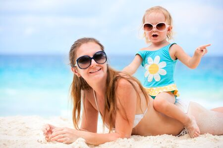 Young mother and her adorable little daughter on beach vacation Stock Photo - 8645624