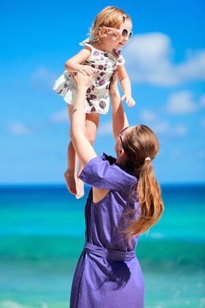 Young mother and her adorable little daughter on beach vacation Stock Photo - 8645603