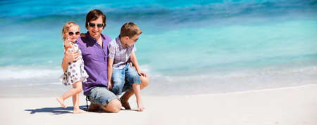Young father with his two kids on tropical beach vacation photo