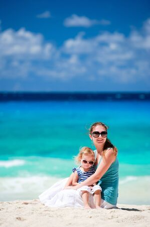 Young mother and her adorable little daughter on beach vacation Stock Photo - 8645605