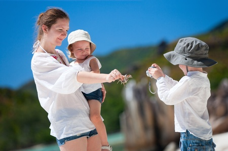 photographing: Little boy photographing his mother and little sister Stock Photo