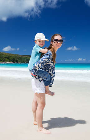 Mother and son on beach vacation having fun photo