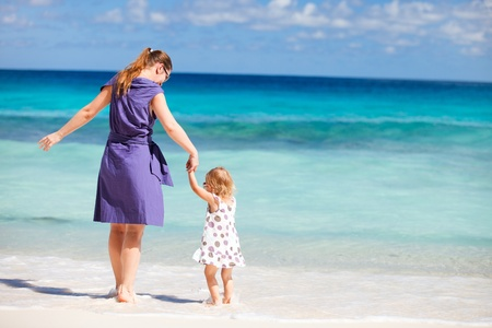 Young mother and her adorable daughter enjoying day at beach Stock Photo - 8645671