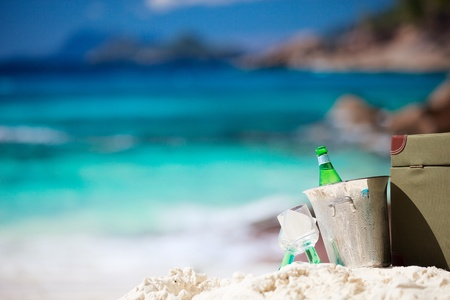 Closeup of romantic picnic on tropical beach photo