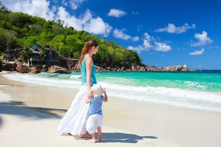 Young mother and her adorable daughter enjoying day at beach Stock Photo - 8703916