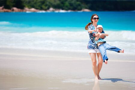 Happy mother and son at tropical beach Stock Photo - 8703978