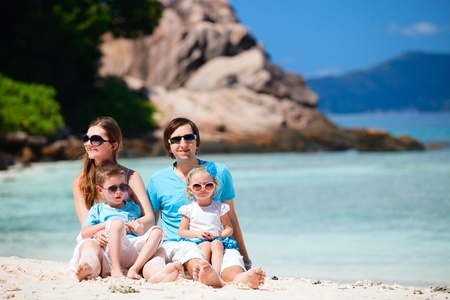 Portrait of happy young family with two kids on tropical vacation Stock Photo - 8704029