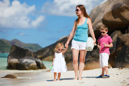 Mother with son and daughter on beach vacation photo