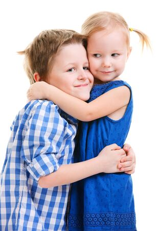 sister: Loving brother and little sister hugging isolated over white