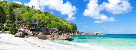Panoramic photo of beautiful Takamaka beach on Mahe island in Seychelles