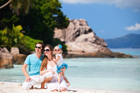 Portrait of happy young family on tropical vacation photo