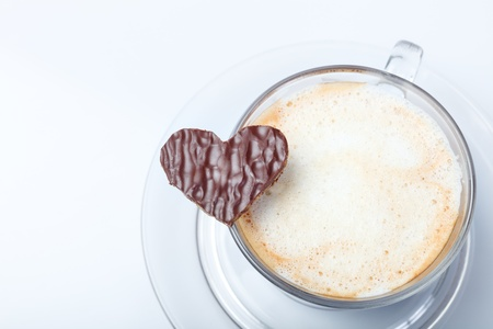 Close up of fresh aromatic coffee and heart shaped cookie photo