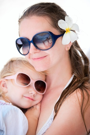 Portrait of loving mother and her adorable little daughter photo