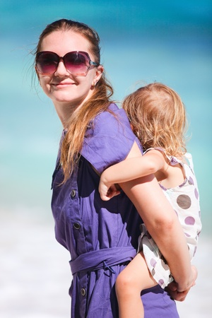 Young mother and her adorable little daughter on tropical vacation photo