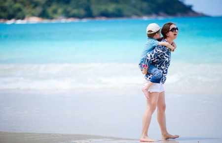 Mother and son on beach vacation having fun Stock Photo - 9166029