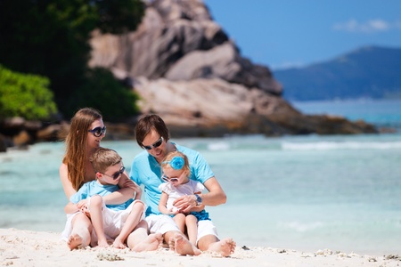 Portrait of happy young family with two kids on tropical vacation Stock Photo - 9166043