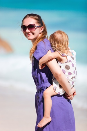 Young mother and her adorable little daughter on tropical vacation Stock Photo - 9166038
