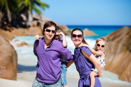 Portrait of happy young family with two kids on tropical vacation Stock Photo - 9166045