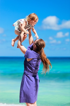 Young mother and her adorable little daughter on beach vacation Stock Photo - 9296889
