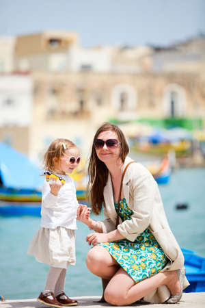 Mother and her little daughter outdoors in European city photo