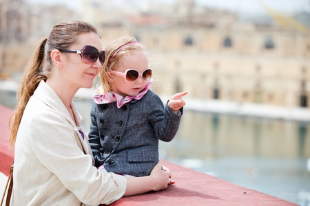 Mother and her little daughter outdoors in European city Stock Photo - 9477710