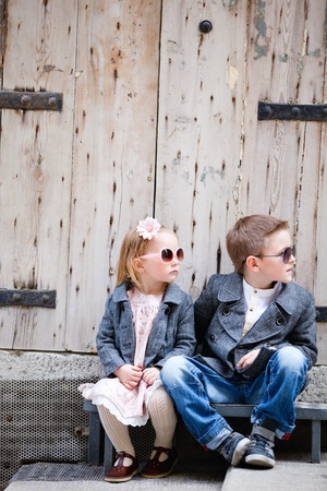 street fashion: Brother and sister outdoors in city on beautiful spring day