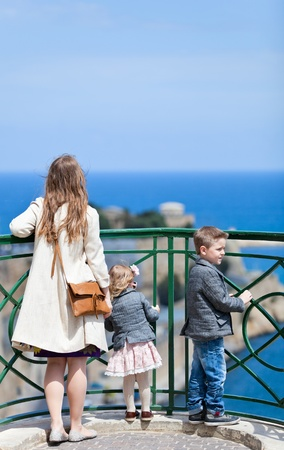 Mother and two kids enjoying views at viewpoint Stock Photo - 9540250