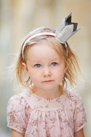 Very cute little princess outdoor portrait Stock Photo - 9591176