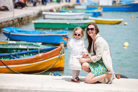 Mother and her little daughter in Marsaxlokk village in Malta photo