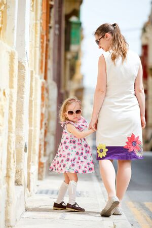 Mother and her little daughter outdoors in European city Stock Photo - 9591187