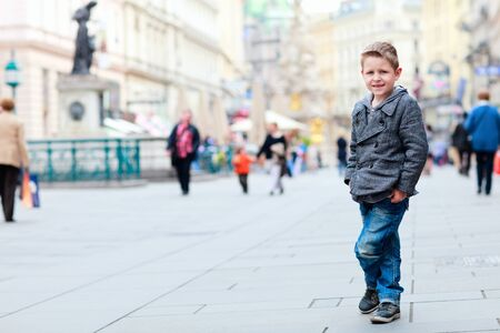 Cute little boy portrait at busy street in city Stock Photo - 9591193