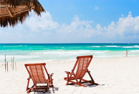 vacation: Two beach chairs on beautiful Caribbean coast Stock Photo