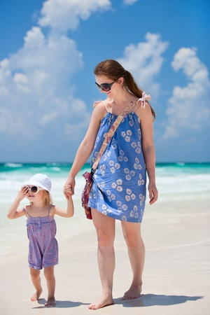 Mother and her little daughter enjoying Caribbean beach vacation Stock Photo - 9773599