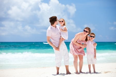 Young beautiful Caucasian family on Caribbean beach vacation photo