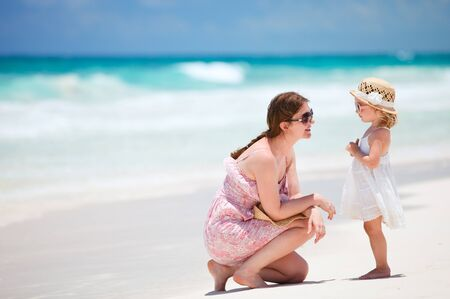 Mother and her little daughter enjoying Caribbean beach vacation photo