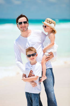 Father and his adorable kids on tropical Caribbean beach photo