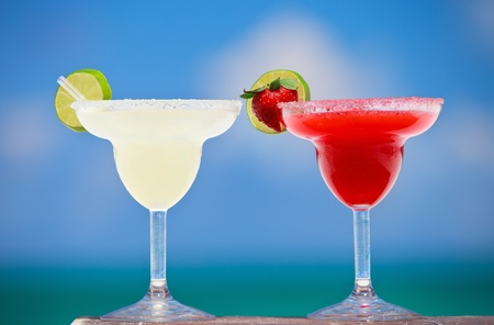 margarita cocktail: Classic and strawberry margarita cocktails at Mexican beach