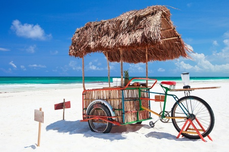 Exotic beach bar transformed from bike at Caribbean beach in Mexico