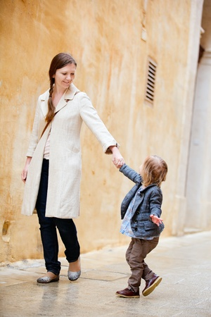 Mother and her little daughter walking in city Stock Photo - 9784293