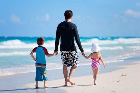 Father with his two kids on tropical beach vacation photo