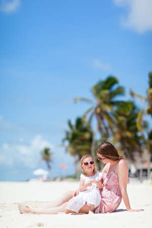 Mother and her little daughter enjoying Caribbean beach vacation Stock Photo - 9784306