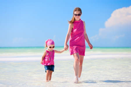 Mother and her little daughter enjoying Caribbean beach vacation Stock Photo - 9784292