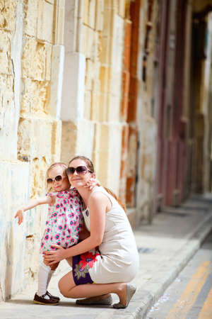 Mother and her little daughter outdoors in European city Stock Photo - 9862640