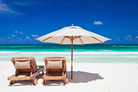 Two chairs and umbrella on stunning tropical beach in Tulum, Mexico Stock Photo - 9862657