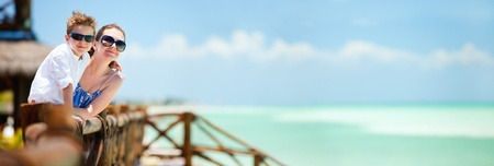 Panoramic photo of mother and son portrait on tropical vacation photo