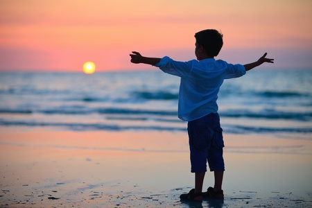 Little boy silhouette on beach at sunset Stock Photo - 9978357
