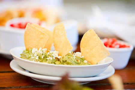 dipping: Traditional mexican guacamole and tortilla chips
