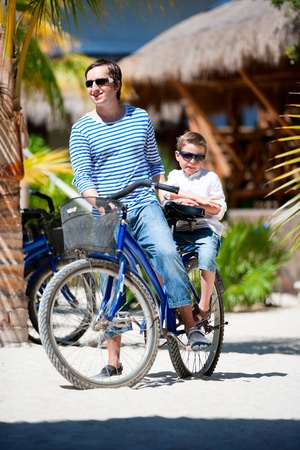 Father and son riding a bike together  Stock Photo - 9978484
