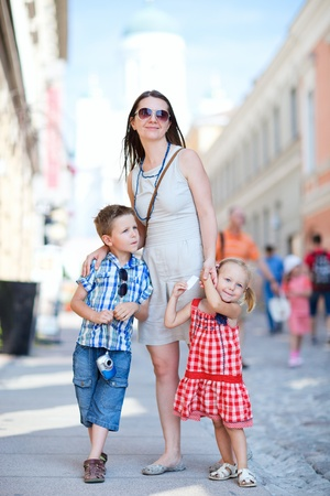 Young beautiful woman with her two kids in city at summer day Stock Photo - 9978468
